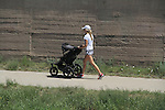 Mother walking with baby stroller Denver, Colorado. .  John offers private photo tours in Denver, Boulder and throughout Colorado. Year-round Colorado photo tours.