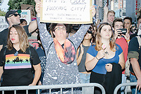 "Counterprotesters hold signs toward, flip-off, and angrily shout at those marching in the Straight Pride Parade in Boston, Massachusetts, on Sat., August 31, 2019. The parade was organized in reaction to LGBTQ Pride month activities by an organization called Super Happy Fun America.  The person's sign here reads ""This is our fucking city! White supremacists = domestic terrorists."""