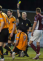 Alloa's Martin Grehan is booked for diving.