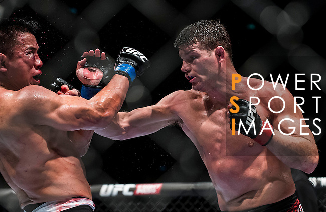 Michael Bisping of Australia vs Cung Le of USA during their middleweight bout fight as part of the UFC Fight Night Macao on August 23, 2014 at the Venetian in Macao, China. Photo by Victor Fraile / Power Sport Images