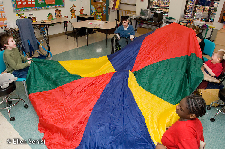 MR / Albany, NY.Langan School at Center for Disability Services .Ungraded private school which serves individuals with multiple disabilities.Children with mixed disabilities (including cerebral palsy and muscular dystrophy) use parachute to develop coordination and grasping skills while playing..MR: AH-cfds.© Ellen B. Senisi