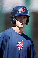 Cleveland Indians minor league outfielder Tyler Naquin #12 during practice before an instructional league game against the Cincinnati Reds at the Goodyear Training Complex on October 8, 2012 in Goodyear, Arizona.  (Mike Janes/Four Seam Images)