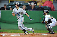 Austin Schotts #5 of the West Michigan Whitecaps swings against the Clinton LumberKings at Ashford University Field on July  25, 2014 in Clinton, Iowa. The Whitecaps won 9-0.   (Dennis Hubbard/Four Seam Images)