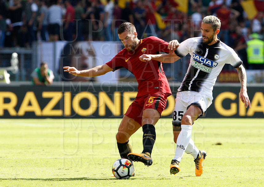 Calcio, Serie A: Roma vs Udinese. Roma, stadio Olimpico, 23 settembre 2017.<br /> Roma's Kevin Strootman, left, is challenged by Udinese's Valon Behrami during the Italian Serie A football match between Roma and Udinese at Rome's Olympic stadium, 23 September 2017. Roma won 3-1.<br /> UPDATE IMAGES PRESS/Riccardo De Luca