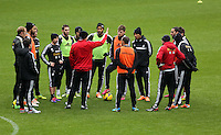 Wednesday 05 February 2014<br /> Pictured: Garry Monk (in red C) speaking to his players<br /> Re: Swansea City FC training with Garry Monk as head coach after the departure of Michael Laudrup, at the Li Liberty Stadium, south Wales.