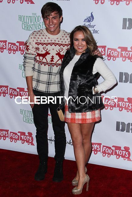 HOLLYWOOD, CA - DECEMBER 01: Lucas Cruikshank, Jennifer Veal arriving at the 82nd Annual Hollywood Christmas Parade held at Hollywood Boulevard on December 1, 2013 in Hollywood, California. (Photo by Xavier Collin/Celebrity Monitor)