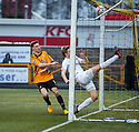 Ayr Utd's Neil McGregor can't stop the ball crossing the line as Mitchel Megginson (9) scores Alloa's first goal .