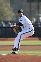 Anthony Meo #13 of the Coastal Carolina University Chanticleers pitching against Boston College Eagles at Watson Stadium at Vrooman Field in Conway, South Carolina on February 18, 2011. Photo by Robert Gurganus/Four Seam Images