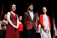 Stage IV finalists Melanie Laurent from France, left, Valerio Lisci from Italy and Mathilde Wauters from Belgium stand for recognition at the awards ceremony of the 11th USA International Harp Competition at Indiana University in Bloomington, Indiana on Saturday, July 13, 2019. (Photo by James Brosher)