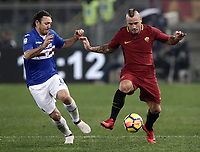 Calcio, Serie A: AS Roma - Sampdoria, Roma, stadio Olimpico, 28 gennaio 2018. <br /> Roma's Radja Nainggolan (r) in action with Sampdoria's Edgar Osvaldo Barreto (l) during the Italian Serie A football match between AS Roma and Sampdoria at Rome's Olympic stadium, January 28, 2018.<br /> UPDATE IMAGES PRESS/Isabella Bonotto