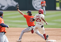 Auburn Tyler Miller (10) tags out Arkansas outfielder Christian Franklin (25), Saturday, April 3, 2021 during the third inning of a baseball game at Baum-Walker Stadium in Fayetteville. Check out nwaonline.com/210404Daily/ for today's photo gallery. <br /> (NWA Democrat-Gazette/Charlie Kaijo)