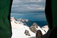 Stunning views across Franz Josef Glacier and toward the Tasman Sea from a tent while camping on the NEVE - Westland National Park, West Coast, New Zealand