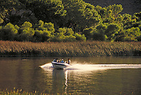 Power boat churns up the water of Diaz Lake. speed, water sports, fresh water, forest. Lone Pine California USA Diaz Lake.
