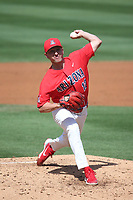 Garrett Irvin (12) of the Arizona Wildcats pitches against the UCLA Bruins at Jackie Robinson Stadium on March 20, 2021 in Los Angeles, California. Arizona defeated UCLA, 7-3. (Larry Goren/Four Seam Images)