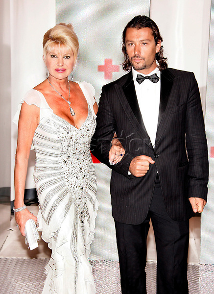 epa00788196 Former model Ivana Trump (L) poses with her boyfriend for photographers during the 58th Red Cross Ball, at the Sporting club in Monte Carlo, Monaco, Friday 04 August 2006.  EPA/ASM CORBIS OUT