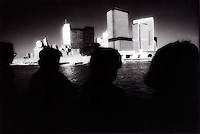 Silhouetted heads with lower Manhattan skyline<br />