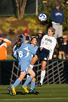 Notre Dame Fighting Irish forward Taylor Knaack (4) heads the ball. The North Carolina Tar Heels defeated the Notre Dame Fighting Irish 2-1 during the finals of the NCAA Women's College Cup at Wakemed Soccer Park in Cary, NC, on December 7, 2008. Photo by Howard C. Smith/isiphotos.com
