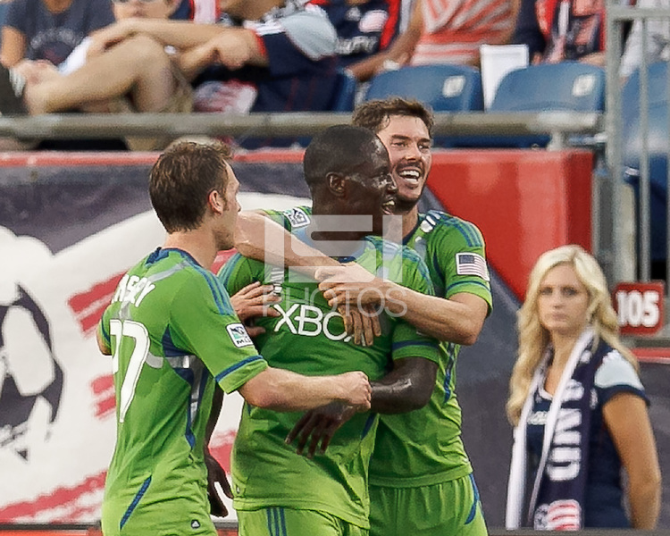 Seattle Sounders FC forward Eddie Johnson (7) celebrates his goal with teammates. In a Major League Soccer (MLS) match, the New England Revolution tied the Seattle Sounders FC, 2-2, at Gillette Stadium on June 30, 2012.