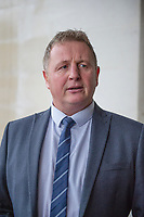 Pictured: DCI Paul Jones of Dyfed Powys police reads a stamens outside Swansea Crown Court, Swansea, Wales, UK. Friday 18 October 2019<br /> Re: A man who fathered at least six children with one of his daughters has been jailed for rape by Swansea Crown Court, Wales, UK.<br /> The defendant, from south west Wales, who cannot be named, was also found guilty of repeatedly raping one of the girls she gave birth to, and another of his daughters.<br /> He had denied a total of 36 counts of rape, and one count of assault by penetration.