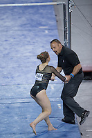 LOS ANGELES, CA - April 19, 2013:  Stanford assistant coach Chris Swircek congratulates Kristina Vaculik on her bars routine during the NCAA Championships at UCLA.