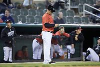 Kannapolis Intimidators manager Justin Jirschele (9) checks his lineup card as he coaches third base during the game against the Lakewood BlueClaws at Kannapolis Intimidators Stadium on April 6, 2018 in Kannapolis, North Carolina.  The BlueClaws defeated the Intimidators 4-3. (Brian Westerholt/Four Seam Images)