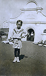 St Louis MO:  A view of a young Philippine girl encouraging people to visit her house in the Philippine Village.  The Philippine Village was one of the most popular international exhibits during the Louisiana Purchase Exposition.