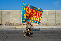 A Colombian man holds a Christian flag during the Carnival in Barranquilla, Colombia, 25 February 2006. The Carnival of Barranquilla is a unique festivity which takes place every year during February or March on the Caribbean coast of Colombia. A colourful mixture of the ancient African tribal dances and the Spanish music influence - cumbia, porro, mapale, puya, congo among others - hit for five days nearly all central streets of Barranquilla. Those traditions kept for centuries by Black African slaves have had the great impact on Colombian culture and Colombian society. In November 2003 the Carnival of Barranquilla was proclaimed as the Masterpiece of the Oral and Intangible Heritage of Humanity by UNESCO.