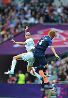 August 07, 2012..Mexico's Jorge Enriquez and Japan's Hiroki Sakai in action during Semi Final match at the Wembley Stadium on day eleven in Wembley, England. Mexico defeat Japan 3-1 to reach Men's Finals of the 2012 London Olympics...