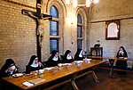 Nuns at St Mary at the Cross Edgware Abbey an Anglican Benedictine Community. Sisters in Refectory (the monastic dining room)  observing silence. Edgware, Middlesex UK 1980s 1989.