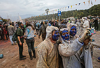 Pictured: Flour wars participants take a selfie in Galaxidi, Greece. Monday 19 February 2018<br /> Re: Clean Monday (Monday of Lent) celebration of flour wars (Alevromoutzouroma) in the town of Galaxidi, which coincides with the beginning of the Greek Orthodox Lent in Greece. The origins of the custom are unclear, however it appears in its current form since the mid-19th century.<br /> Locals and visitors of all ages gather to collect large quantities of flour which they throw to each other. Various types of coloring is added for effect while people paint their faces with charcoal.