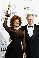 Sophia Loren and Charlton Heston at the 1995 Golden Globe Awards where she won for Contribution to Film.