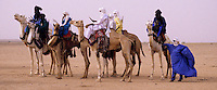 In-Gall, near Agadez, Niger - Tuaregs with Camels at Annual Cure Salé, Annual Gathering of Tuareg Nomads.  As is their custom, most of the men cover their mouths with the tagulmust, the Tuareg veil.