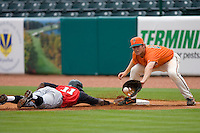 Justin Greene #11 of the Kannapolis Intimidators dives back towards first base as Ben Lasater #23 of the Greensboro Grasshoppers waits for the throw at NewBridge Bank Park June 20, 2009 in Greensboro, North Carolina. (Photo by Brian Westerholt / Four Seam Images)