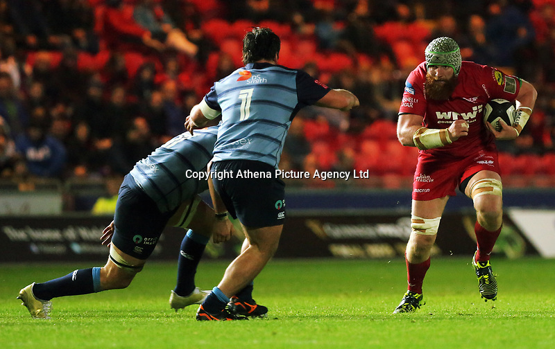 Jake Ball of the Scarlets (R) runs towardsBradley Thyer of Cardiff Blues (C) during the Guinness PRO14 match between Scarlets and Cardiff Blues at Parc Y Scarlets Stadium, Llanelli, Wales, UK. Saturday 28 October 2017