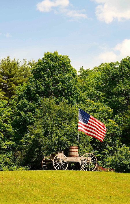 Old Glory atop an old wagon.