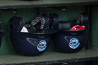 A pair of Lakewood BlueClaws batting helmets sit in the dugout prior to the game against the Kannapolis Intimidators at Kannapolis Intimidators Stadium on April 6, 2017 in Kannapolis, North Carolina.  The BlueClaws defeated the Intimidators 7-5.  (Brian Westerholt/Four Seam Images)