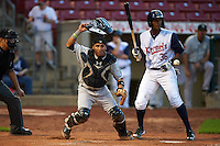 Kane County Cougars catcher Michael Perez (9) makes a play on the ball as Edgar Corcino (36) looks on during a game against the Cedar Rapids Kernels on August 18, 2015 at Perfect Game Field in Cedar Rapids, Iowa.  Kane County defeated Cedar Rapids 1-0.  (Mike Janes/Four Seam Images)