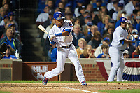 Chicago Cubs Addison Russell (27) swings at a pitch in the eighth inning during Game 3 of the Major League Baseball World Series against the Cleveland Indians on October 28, 2016 at Wrigley Field in Chicago, Illinois.  (Mike Janes/Four Seam Images)