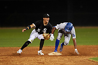 AZL Dodgers Lasorda Aldrich De Jongh (3) slides into second base ahead of the tag by Harold Diaz (15) during an Arizona League game against the AZL White Sox at Camelback Ranch on June 18, 2019 in Glendale, Arizona. AZL Dodgers Lasorda defeated AZL White Sox 7-3. (Zachary Lucy/Four Seam Images)