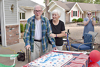 Rachel Dickerson/The Weekly Vista World War II veteran Joe Skourup, left, is pictured with neighbor Pat Slatton, center, while celebrating his 97th birthday in Bella Vista on June 9.