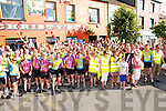 The Cycling  Tour of Munster in aid of Down Syndrome , Ireland which stopped off in Listowel on Friday evening last pictured in front of Christy's Bar where the had some refreshments. Cycling hero Sean Kelly is in black at front letf of picture.