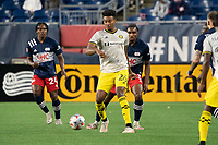 FOXBOROUGH, MA - MAY 16: Saad Abdul-Salaam #26 Columbus SC passes the ball downfield during a game between Columbus SC and New England Revolution at Gillette Stadium on May 16, 2021 in Foxborough, Massachusetts.