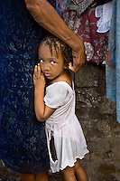 Devastation after the January 12, 2010 earthquake. Displaced people living in makeshift shelters in Place Boyer, Petionville. Little girl.2/2/10