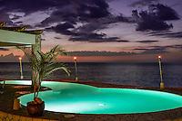 Resort oceanfront pool at dusk, Negril, Jamaica