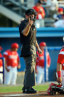 Home plate umpire Sam Vogt during a game between the Batavia Muckdogs and Connecticut Tigers at Dwyer Stadium on July 5, 2012 in Batavia, New York.  Batavia defeated Connecticut 8-2.  (Mike Janes/Four Seam Images)