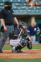 Matt Thaiss (6) of the Salt Lake Bees on defense against the Tacoma Rainiers while home plate umpire Tom Woodring handles the calls at Smith's Ballpark on May 13, 2021 in Salt Lake City, Utah. The Rainiers defeated the Bees 15-5. (Stephen Smith/Four Seam Images)