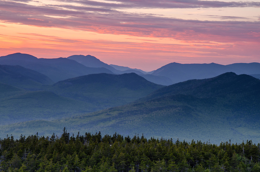 Humid air trapped in the valleys of the Pemigewasset Wilderness will be fog by morning, but first the sun must set...