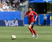 GRENOBLE, FRANCE - JUNE 12: Soyun Ji #10 of the Korean National Team dribbles during a game between Korea Republic and Nigeria at Stade des Alpes on June 12, 2019 in Grenoble, France.