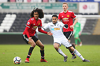 Sunday 18 March 2018<br /> Pictured:  Kenji Gorre of Swansea City is marked by Tahith Chong of Manchester United<br /> Re: Swansea City v Manchester United U23s in the Premier League 2 at The Liberty Stadium on March 18, 2018 in Swansea, Wales.