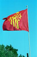 The red and yellow Languedoc flag against a blue sky on a flag pole at Chateau de l'Engarran, Laverune, Coteaux du Languedoc St George d'Orques, Languedoc-Roussillon, France